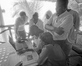 Training East African technicians to set up wireless internet connections (2005). Photo: Rana Ghose
