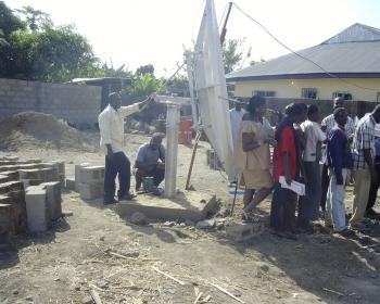 Fantsuam Foundation workers erect a satellite internet connection. Photo: Fantsuam Foundation (2003)