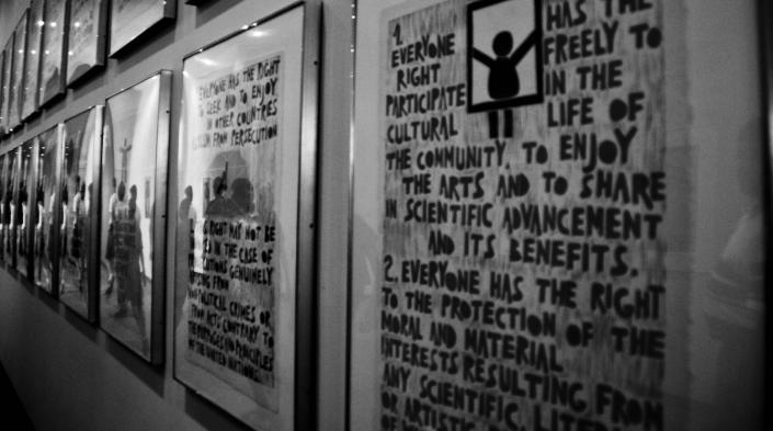 Image by Zack Lee, used under Creative Commons license. Photo of framed representations of each human right included in the Declaration of Human Rights at UN.