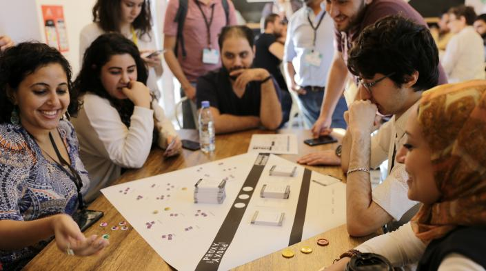Bread&Net 2018 attendees playing PROXY, during a session testing the board game designed to teach Lebanese youth about online mobile privacy and security. Photo: Muriele Honein/SMEX)