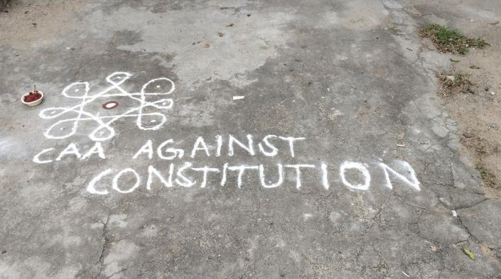 """""""Kolam"""" or rice flour drawing created during a peaceful protest against the CAA in Chennai."""