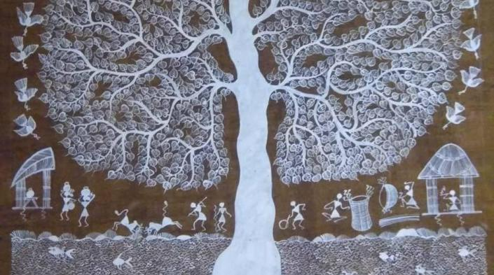 Image: Warli art depicting tree foliage and people doing different things below the shade. Photograph source: Authors