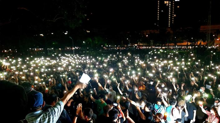 Students light their mobile phones during a protest against the government at Kasetsart University on February 29, 2020. Photo by Chonthicha Jangrew.